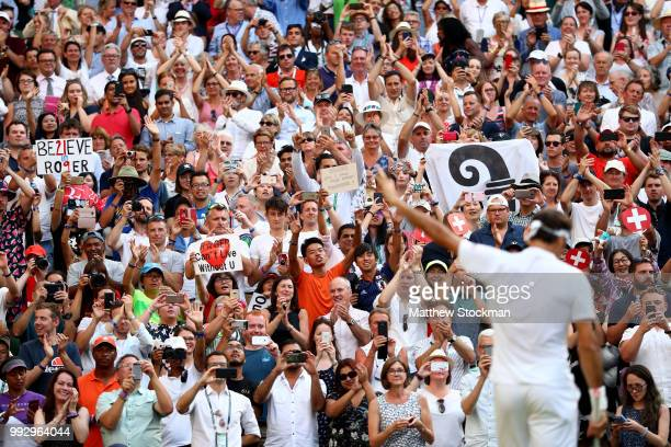 Fans cheer as Roger Federer of Switzerland celebrates after defeating JanLennard Struff of Germany in their Men's Singles third round match on day...