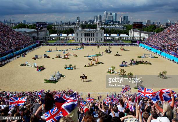 Fans cheer as Scott Brash of Great Britain riding Hello Sanctos finishes the 3rd Qualifier of Individual Jumping on Day 10 of the London 2012 Olympic...