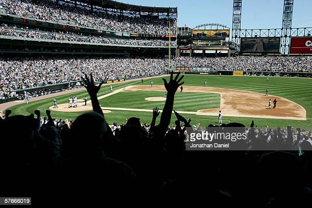 Fans cheer as Tadahito Iguchi of the Chicago White Sox rounds third base after hitting a grand slam home run in the 2nd inning against the Chicago...
