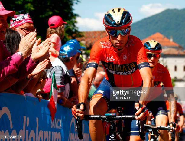 Fans cheer as Team Bahrain rider Italy's Vincenzo Nibali goes to the sign in ceremony prior to stage twenty of the 102nd Giro d'Italia Tour of Italy...