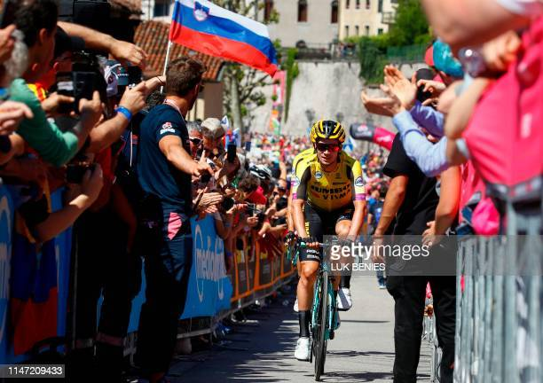 Fans cheer as Team Jumbo rider Slovenia's Primoz Roglic goes to the sign in ceremony prior to stage twenty of the 102nd Giro d'Italia Tour of Italy...