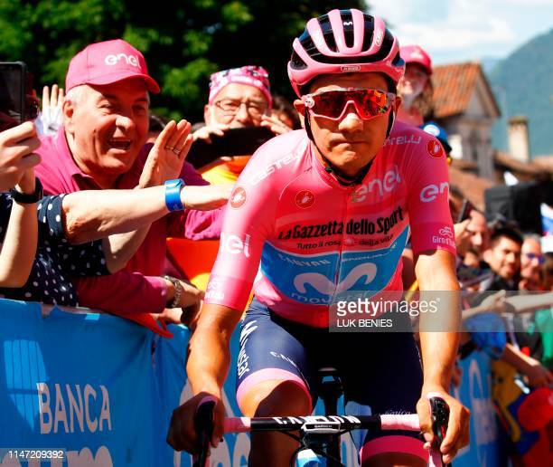 Fans cheer as Team Movistar rider Ecuador's Richard Carapaz goes to the sign in ceremony prior to stage twenty of the 102nd Giro d'Italia Tour of...
