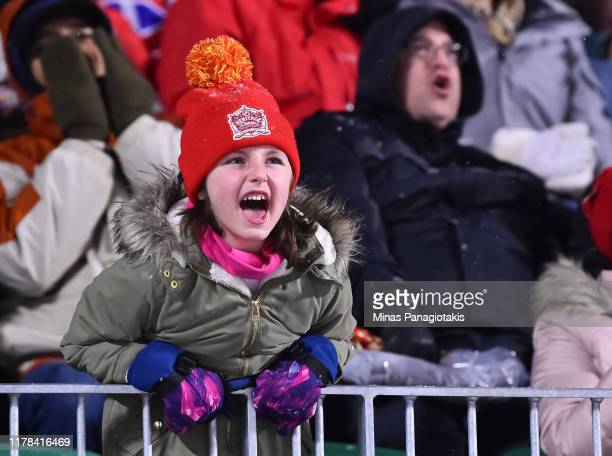 Fans cheer as the Calgary Flames take on the Winnipeg Jets during the 2019 Tim Hortons NHL Heritage Classic at Mosaic Stadium on October 26, 2019 in...