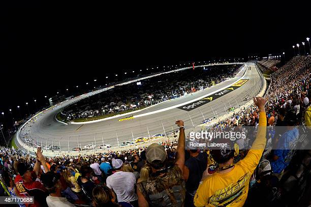 Fans cheer as the field passes by during the NASCAR Sprint Cup Series Bojangles' Southern 500 at Darlington Raceway on September 6 2015 in Darlington...