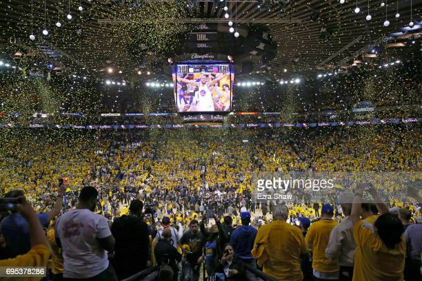 Fans cheer as the Golden State Warriors celebrate after defeating the Cleveland Cavaliers 129120 in Game 5 to win the 2017 NBA Finals at ORACLE Arena...