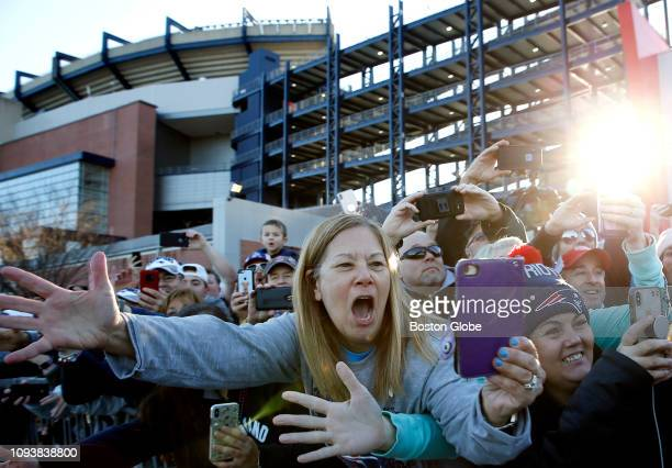Fans cheer as the New England Patriots return from Atlanta to Gillette Stadium in Foxborough MA following their victory over the Los Angeles Rams in...
