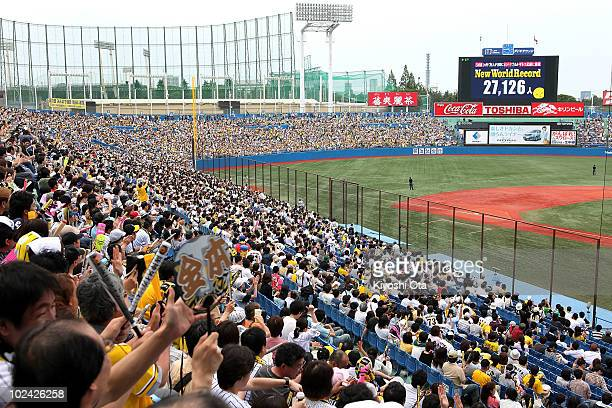 Fans cheer as the new Guinness World Record for the largest toast is displayed on the large screen after the attempt during the eighth inning of the...