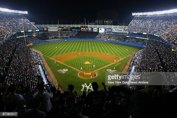 Fans cheer as the New York Yankees take on the Boston Red Sox in Game 2 of the American League Championship Series at Yankee Stadium The Yanks went...