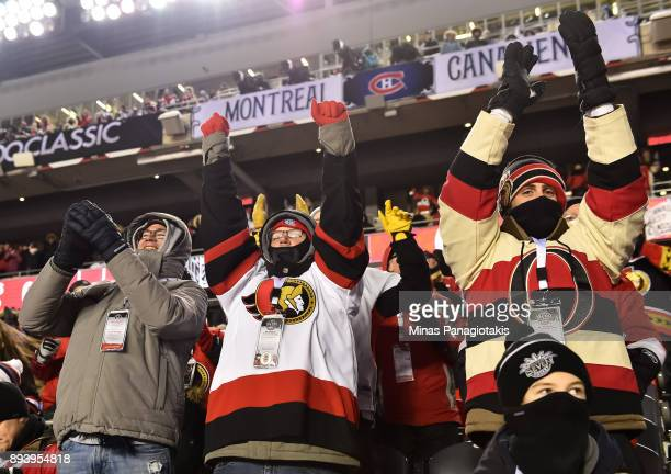 Fans cheer as the Ottawa Senators take on the Montreal Canadiens during the 2017 Scotiabank NHL100 Classic at Lansdowne Park on December 16 2017 in...