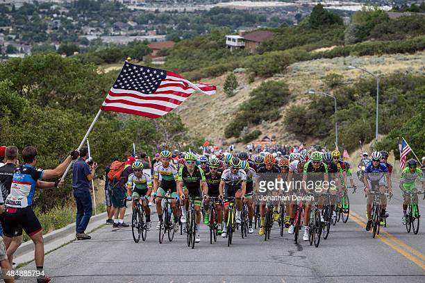 Fans cheer as the peloton hits the final climb towards the finish during stage 3 of the Tour of Utah on August 5 2015 in Bountiful Utah