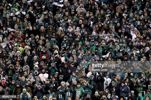 Fans cheer as the Philadelphia Eagles take on the Atlanta Falcons during the third quarter in the NFC Divisional Playoff game at Lincoln Financial...