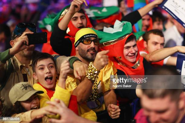 Fans cheer as the players walk on stage on day ten of the 2018 William Hill PDC World Darts Championships at Alexandra Palace on December 23, 2017 in...