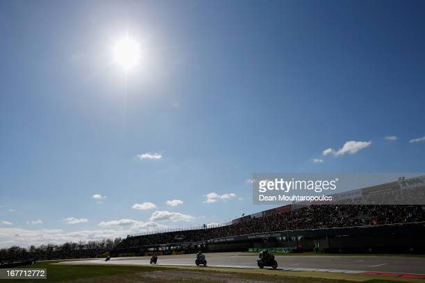 fans cheer as the riders go past the Geert Timmer Tribune during the World Superbikes race 2 at TT Circuit Assen on April 28 2013 in Assen Netherlands