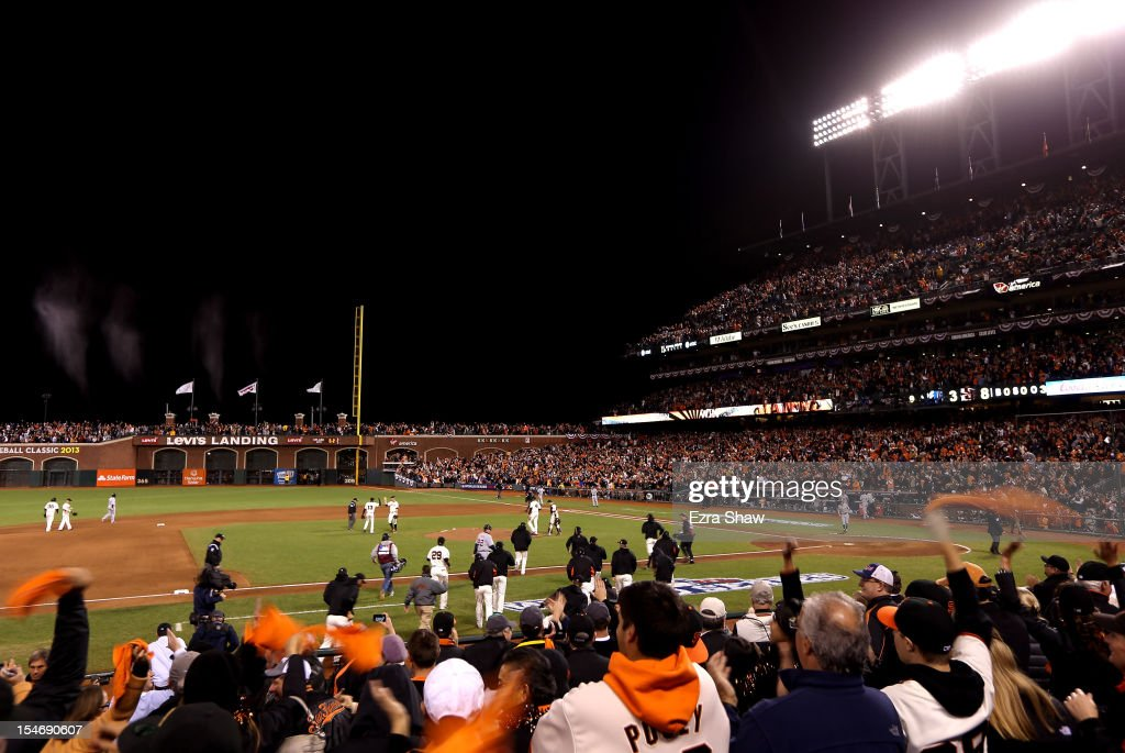 Fans cheer as The San Francisco Giants celebrate after defeating the Detroit Tigers in Game One of the Major League Baseball World Series at AT&T Park on October 24, 2012 in San Francisco, California. The Giants defeated the Tigers 8-3.