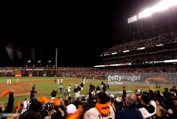 Fans cheer as The San Francisco Giants celebrate after defeating the Detroit Tigers in Game One of the Major League Baseball World Series at ATT Park...