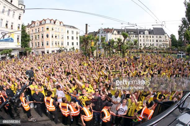 Fans cheer as the team arrives at Borsigplatz during celebrations after winning the German Cup final in Dortmund western Germany on May 28 2017 / AFP...