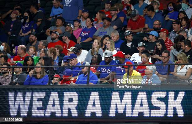 Fans cheer as the Texas Rangers take on the Los Angeles Angels at Globe Life Field on April 28, 2021 in Arlington, Texas.