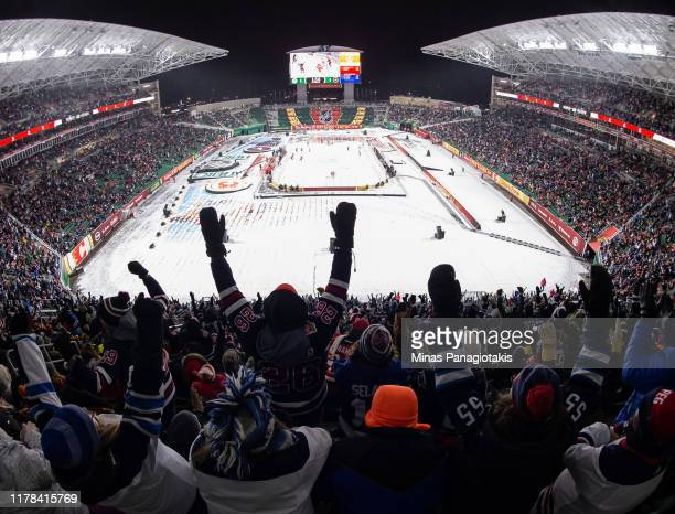 Fans cheer as the Winnipeg Jets win 21 over the Calgary Flames during the 2019 Tim Hortons NHL Heritage Classic at Mosaic Stadium on October 26 2019...