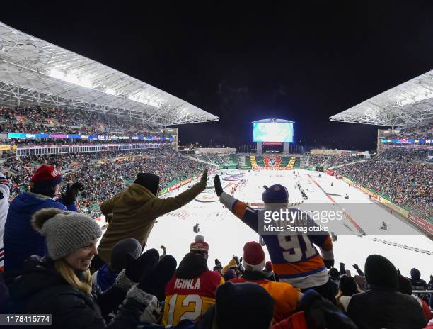 Fans cheer as the Winnipeg Jets win 2-1 over the Calgary Flames during the 2019 Tim Hortons NHL Heritage Classic at Mosaic Stadium on October 26,...