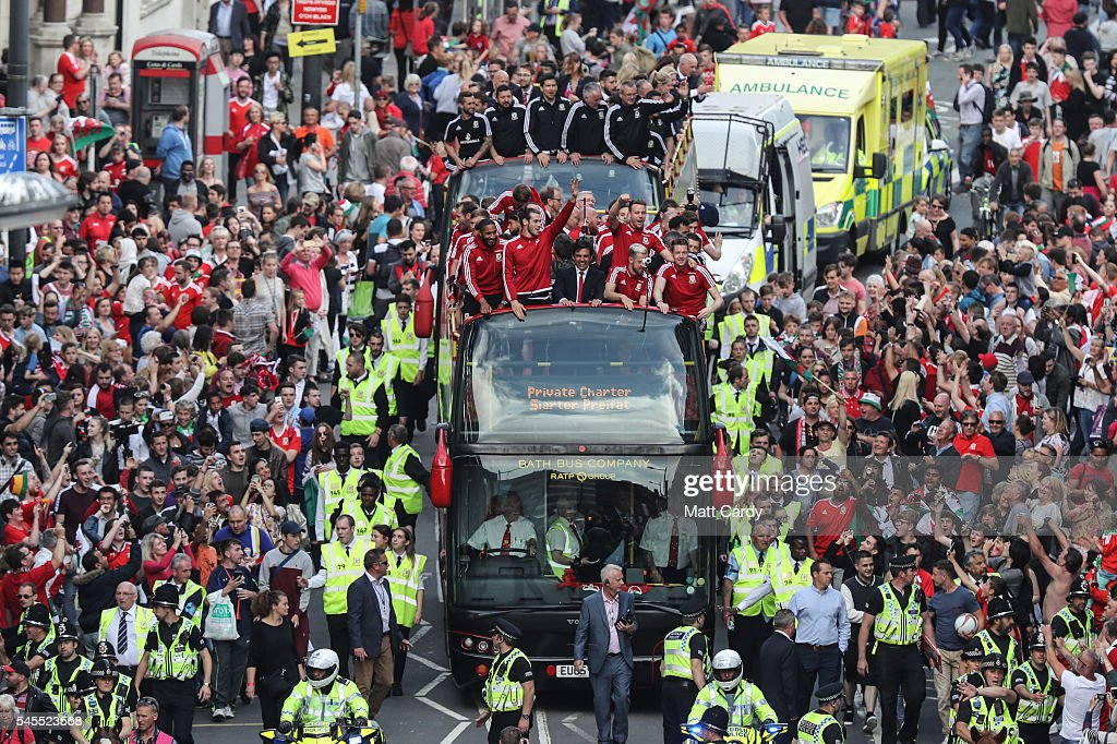 Fans cheer as they line Westgate Street to welcome the Wales team home following their exit from the Euro 2016 championships, on July 8, 2016 in Cardiff, Wales. Wales' fairytale run ended on Wednesday after they were beaten 2-0 by Portugal in their Euro 2016 semi-final match