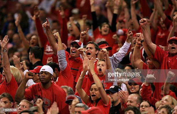 UNLV fans cheer as they take on the Oregon Ducks during the midwest regionals of the NCAA Men's Basketball Tournament at the Edward Jones Dome on...