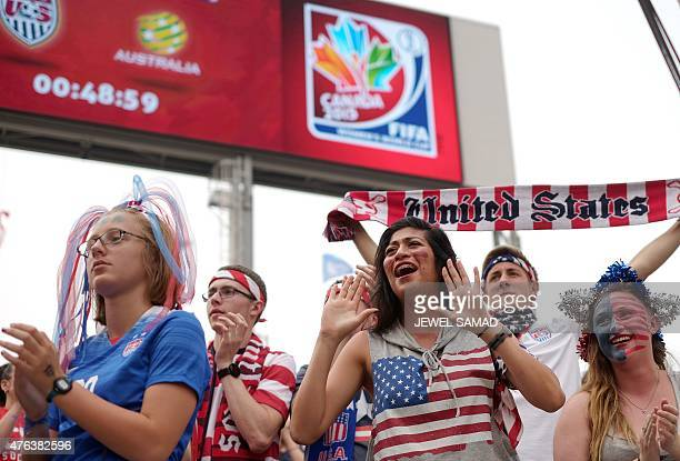 Fans cheer as they wait for the start of the Group D match of the 2015 FIFA Women's World Cup between the USA and Australia at the Winnipeg Stadium...