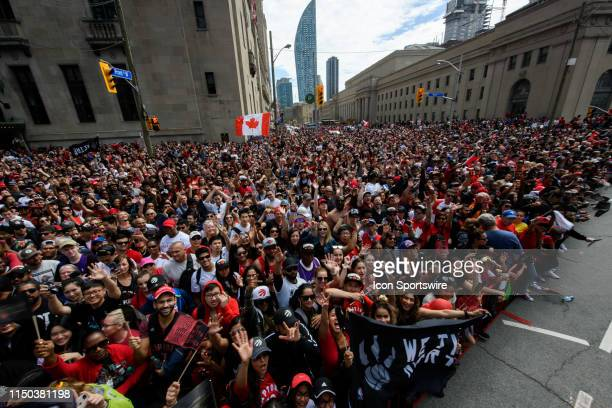 Fans cheer as they wait for the Toronto Raptors Championship parade on June 17 2019 in Toronto ON Canada