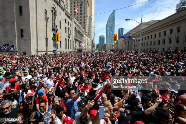 Fans cheer as they watch the Toronto Raptors Championship parade on June 13 2019 in Toronto ON Canada