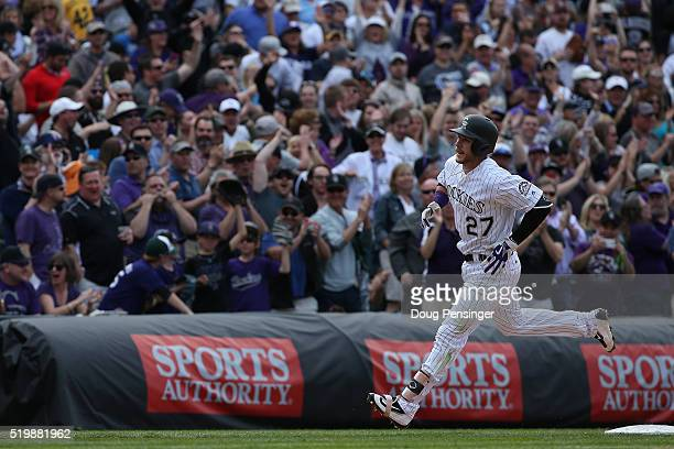 Fans cheer as Trevor Story of the Colorado Rockies rounds the bases on his two run home run off of Colin Rea of the San Diego Padres as the Padres...