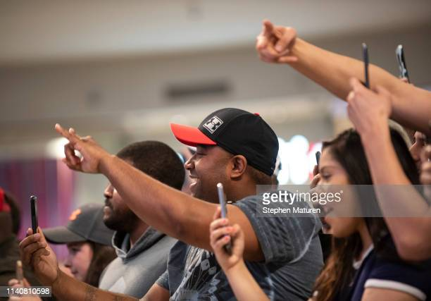 Fans cheer as Tyron Woodley takes the stage during the UFC Fight Night Open Workouts event at the Mall of America on May 2 2019 in Minneapolis...