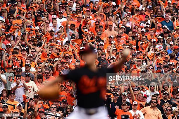 Fans cheer as Wei-Yin Chen of the Baltimore Orioles throws a pitch in the second inning against the Detroit Tigers during Game Two of the American...