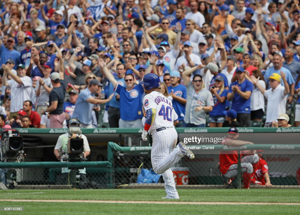 Fans cheer as Willson Contreras #40 of the Chicago Cubs runs the bases after hitting a two run home run in the 6th inning against the Washington Nationals at Wrigley Field on August 5, 2017 in Chicago, Illinois.