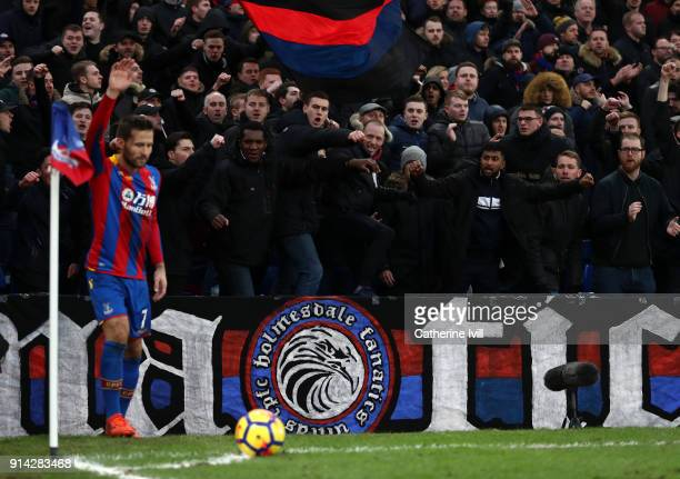 Fans cheer as Yohan Cabaye of Crystal Palace prepares to take a corner during the Premier League match between Crystal Palace and Newcastle United at...