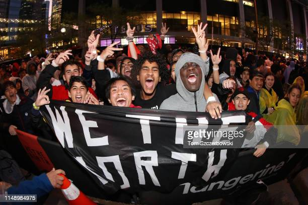 Fans cheer at Jurassic Park as they watch the Golden State Warriors play against the Toronto Raptors during Game Five of the 2019 NBA Finals at...