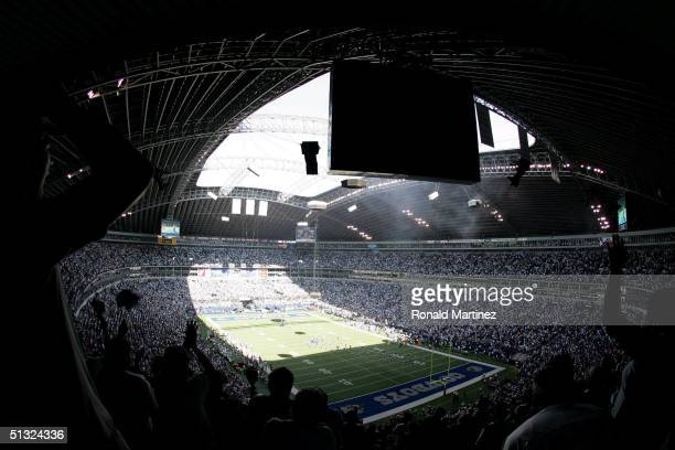 Fans cheer at kickoff of the Dallas Cowboys and the Cleveland Browns on September 19 2004 at Texas Stadium in Irving Texas