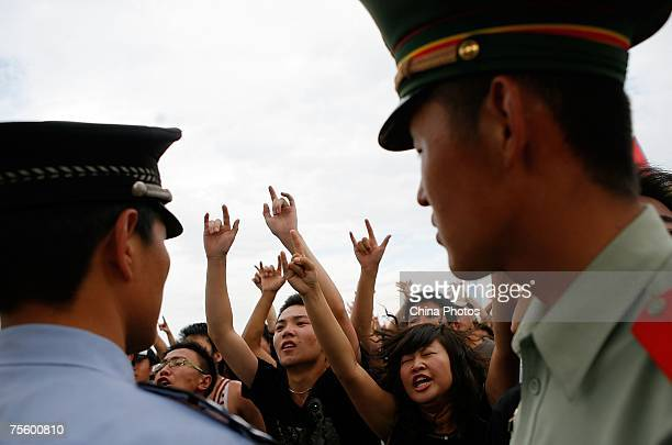 Fans cheer at the first 'Green Flag Erdos Grassland Rock Music Festival' near the Mausoleum of Genghis Khan on July 21 2007 in Erdos of Inner...