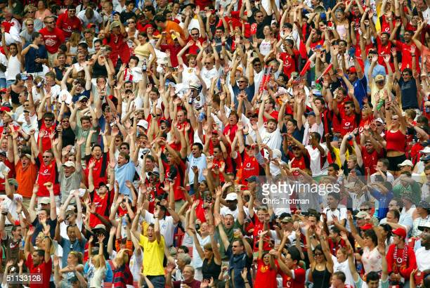 Fans cheer at the Manchester United versus AC Milan soccer game in the Champions World Series at Giants Stadium on July 31, 2004 in East Rutherford,...
