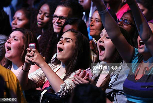 TORONTO ON JUNE 15 Fans cheer at the Much Music Video Awards at MuchMusic on Queen Street West in Toronto June 15 2014
