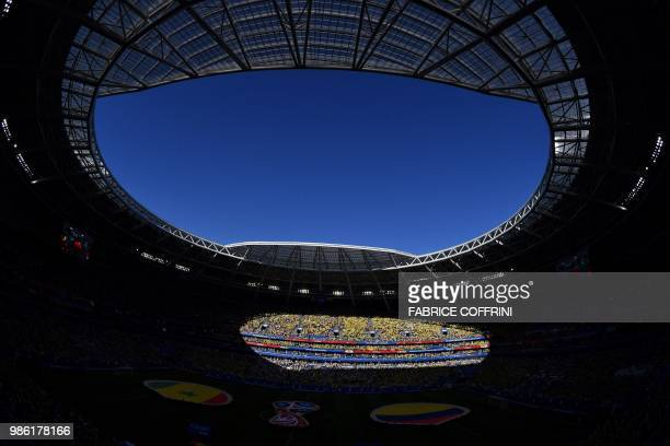 TOPSHOT Fans cheer at the start of the Russia 2018 World Cup Group H football match between Senegal and Colombia at the Samara Arena in Samara on...