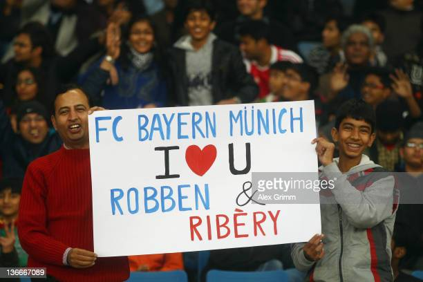 Fans cheer before the international friendly match between Team India and Bayern Muenchen at the Jawaharlal Nehru Stadium on January 10 2012 in Delhi...
