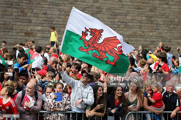 Fans cheer before the start of the parade as the Wales team are welcomed home following their exit from the Euro 2016 championships on July 8 2016 in...