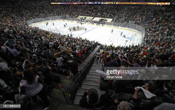 Fans cheer before the start of the second period of Game Three of the Second Round of the 2021 Stanley Cup Playoffs between the Colorado Avalanche...
