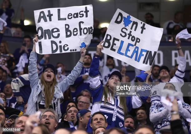 TORONTO ON APRIL 23 Fans cheer during a break in play as the Toronto Maple Leafs play the Boston Bruins in game six of their first round NHL Stanley...