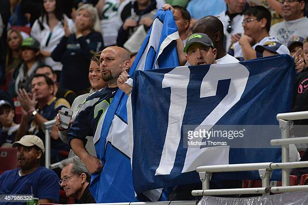 Fans cheer during a game between the St Louis Rams and the Seattle Seahawks at the Edward Jones Dome on October 19 2014 in St Louis Missouri