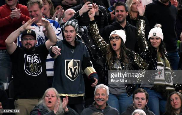 Fans cheer during a game between the Toronto Maple Leafs and the Vegas Golden Knights at TMobile Arena on December 31 2017 in Las Vegas Nevada The...