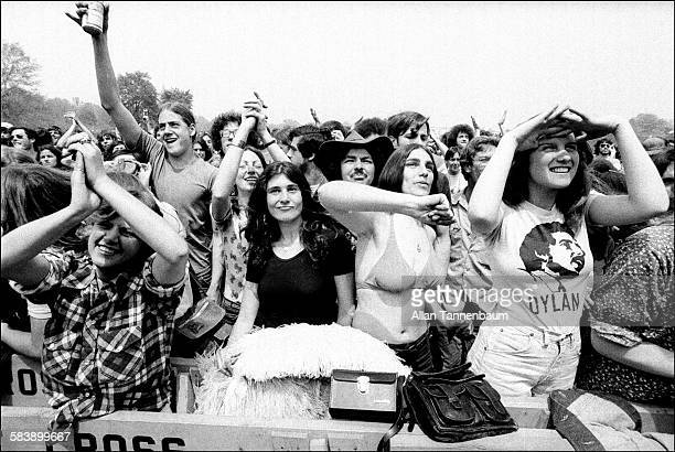 Fans cheer during a performance by Jefferson Starship in Central Park New York New York May 1975