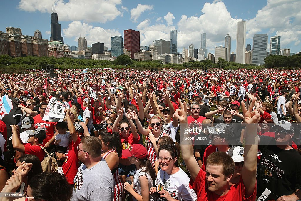 Fans cheer during a rally for the Chicago Blackhawks at Grant Park on June 28, 2013 in Chicago, Illinois. The Blackhawks defeated the Boston Bruins in 6 games to win the National Hockey League's Stanley Cup for the second time in four seasons.