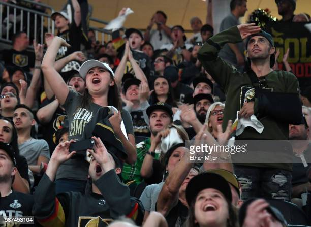 Fans cheer during a Vegas Golden Knights road game watch party for Game Four of the 2018 NHL Stanley Cup Final between the Golden Knights and the...