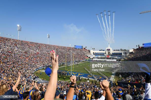 Fans cheer during a Veterans Day salute to service at Los Angeles Memorial Coliseum on November 11 2018 in Los Angeles California