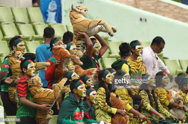 Fans cheer during day two of the First Test match between Bangladesh and Australia at Shere Bangla National Stadium on August 28 2017 in Mirpur...